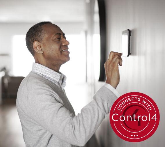 guy ajusting thermostat