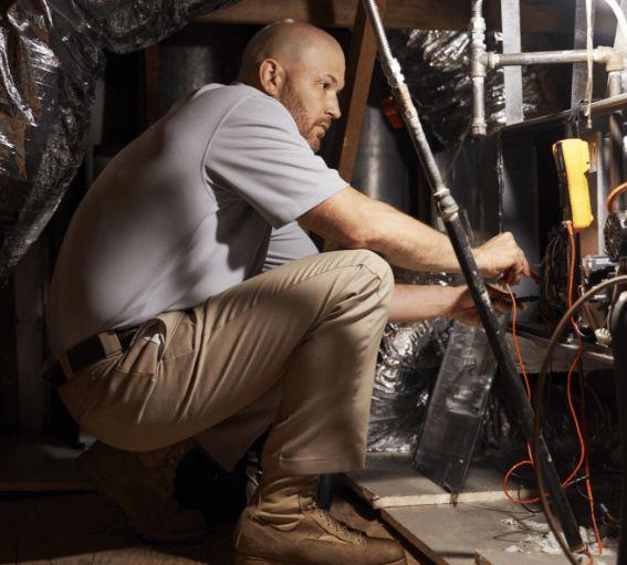 Technician servicing an HVAC system