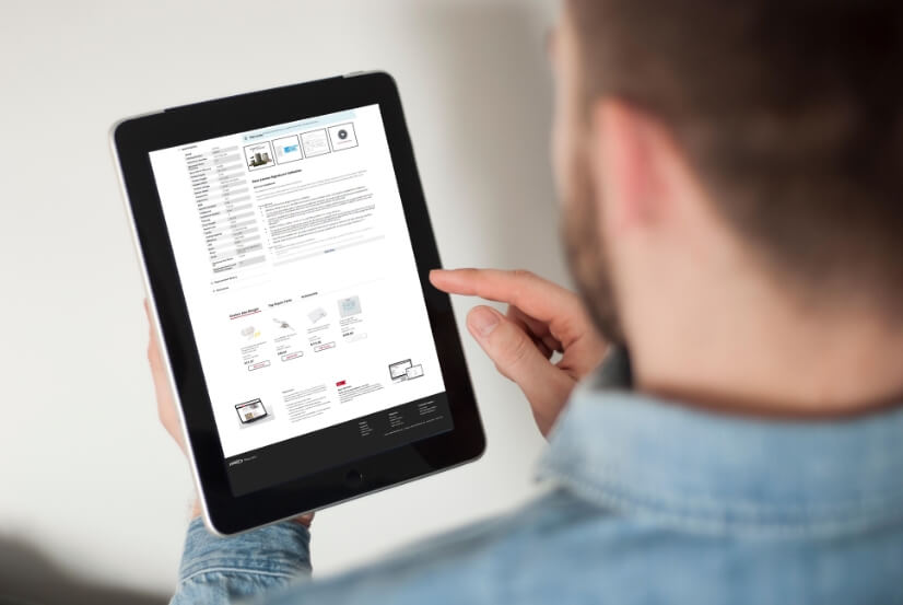 person holding a tablet showing new product page