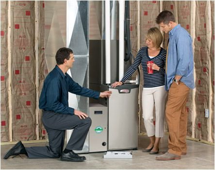 Homeowners with their new furnace
