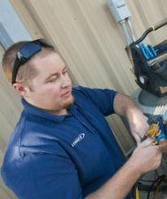 Photo of a technician working on HVAC equipment
