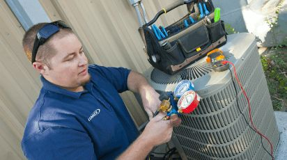 Photo of a technician working on HVAC equipment